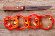 sliced red bell peppers and old knife