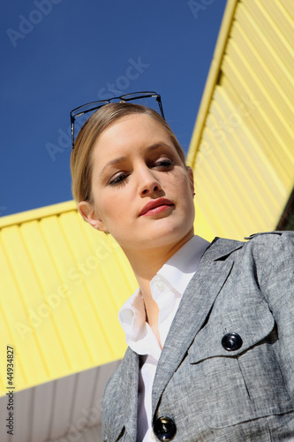 Trendy businesswoman outside an industrial unit