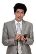 young businessman holding a cell phone