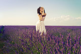Romantic woman in fairy lavender fields