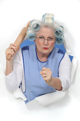 A menacing old lady holding a rolling-pin