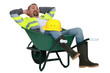 Man taking a snooze in a wheelbarrow