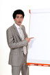businessman pointing at a white board