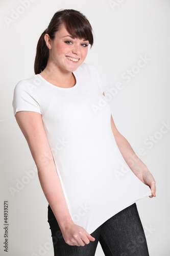 Women stood stretching her t-shirt
