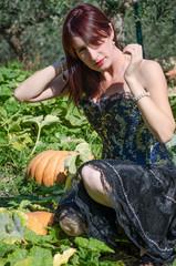 Girl and pumpkins