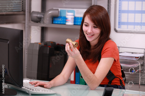 Girl ordering pipes on the computer