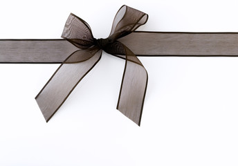 Black ribbon against white background