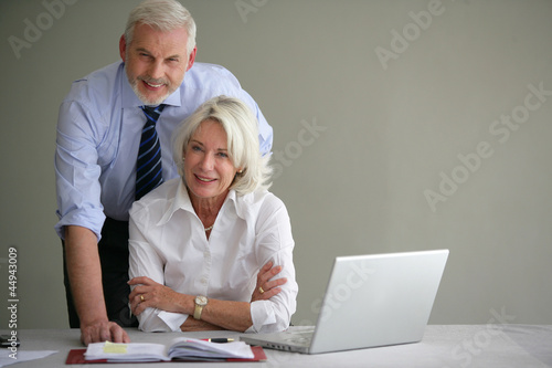 Senior businesspeople in office