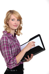 Casual female worker holding folder