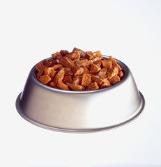 Dog food in bowl against white background