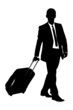 A silhouette of a business traveler carrying a suitcase
