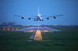canvas print picture - passenger plane fly up over take-off runway from airport