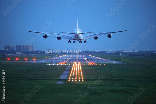 canvas print picture passenger plane fly up over take-off runway from airport