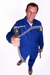 Plumber holding tap