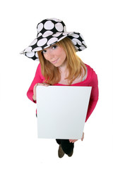 woman in a floppy hat holding a board for your message