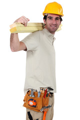Artisan carrying wooden slats on his back