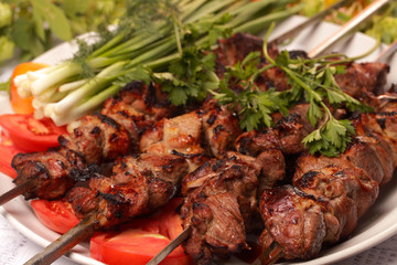 grilled meat on skewers