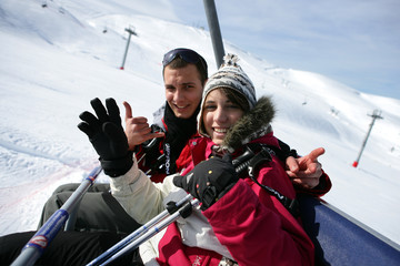 duo at ski in ski lift