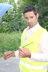 Man checking his oil dipstick