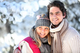 Fototapety portrait of happy couple at winter resort