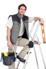 Tiler stood on ladder