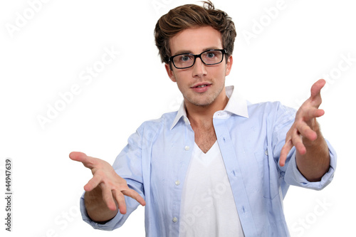 man with glasses explaining