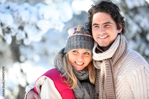 portrait of happy couple at winter resort