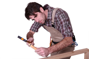 carpenter at work using hammer