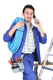 Plumber with materials, toolbox and cellphone