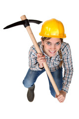 A female construction worker with a pickaxe.