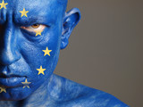 Man face painted with the flag of European Union