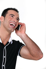 Man on the phone laughing