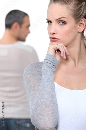 Blond woman grimacing