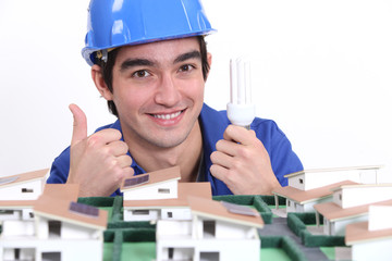 Electrician holding bulb