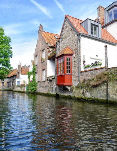 Old houses on the water in Bruges