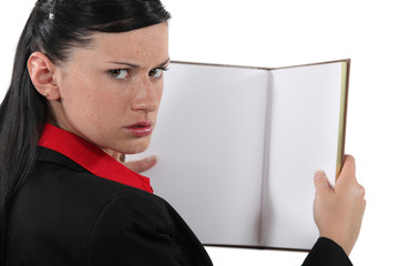 Annoyed businesswoman with a blank book
