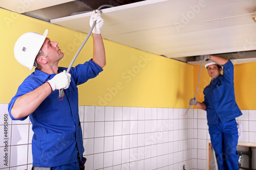 duo of electricians working indoors
