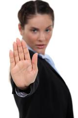 Businesswoman making stop gesture