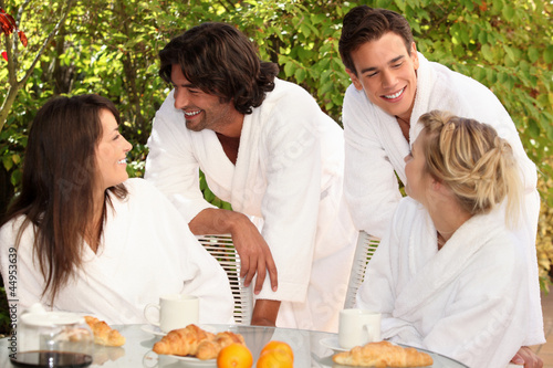 Two couples having breakfast in the garden