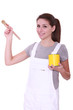 Woman holding paint tin and brush