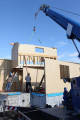 Wooden house frame being built