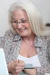 Elderly woman buying on-line