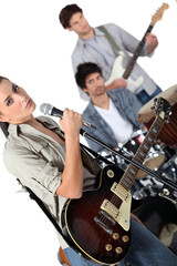 Angled studio shot of a young rock band