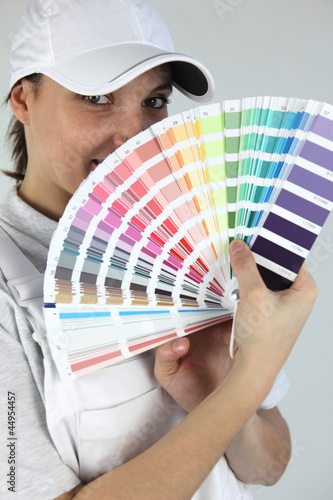 Woman decorator showing swatches
