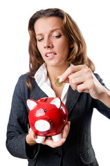 Woman with piggybank on white