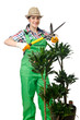 Woman gardener trimming plans on white