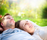 Young Couple Lying on Grass Outdoor - 44957467