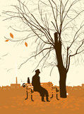 single man with a cat in the autumn tree in the park