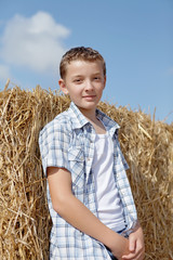 cute boy on a background of rural