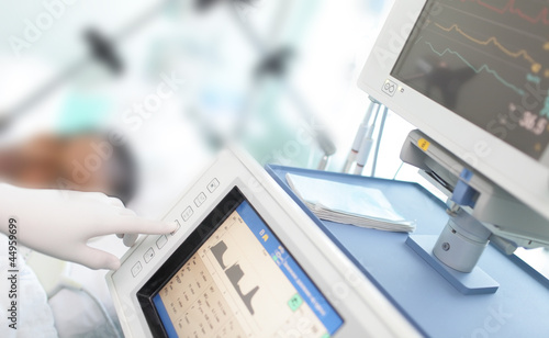 In the ICU. Doctor changes the parameters artificial lung ventil